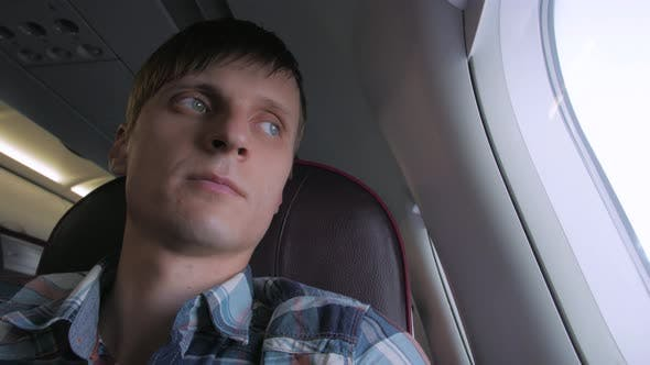 Thumbnail for Young Smiling Man On Plane