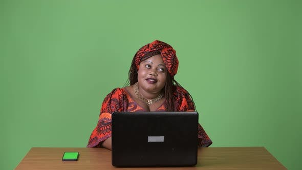 Thumbnail for Overweight Beautiful African Woman Wearing Traditional Clothing Against Green Background