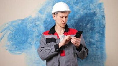 Concentrated Worker Looks for Repair Material Via Internet