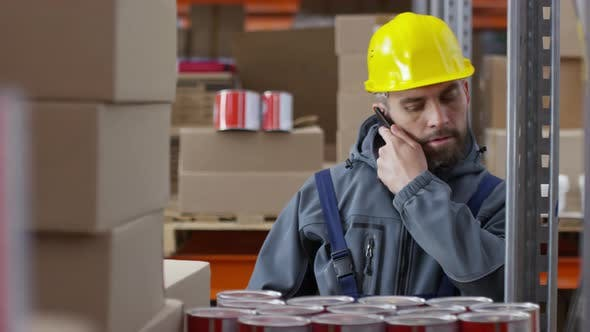 Thumbnail for Warehouse Worker Chatting on Mobile Phone at Work