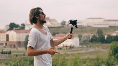 Young Bearded Man Blogger or Vlogger Recording Video Movie