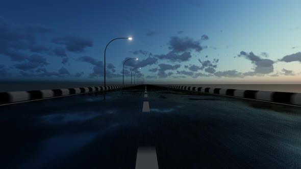 Wet Asphalt Road at Evening