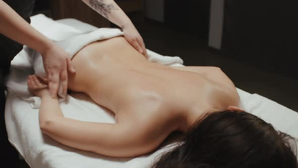 Thumbnail for Brunette Woman Receiving Back Massage Rejuvenating Procedure in Spa Center
