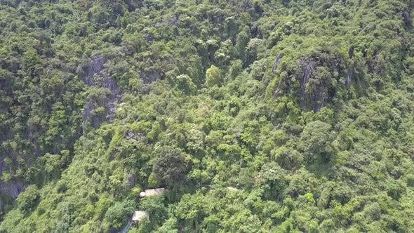 Thumbnail for Mountain with Houses Hidden in Deep Jungle Aerial View
