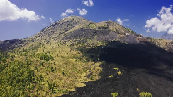 Thumbnail for Frozen Black Lava and Green Trees on the Slope of Volcano Batur on Bali, Indonesia. Aerial View