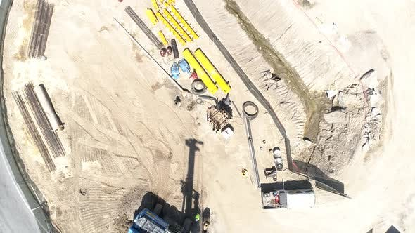 Aerial Top Down of Builders Working on Construction Road