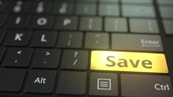 Thumbnail for Black Computer Keyboard and Gold Save Key