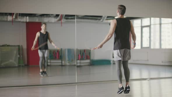 Thumbnail for Fitness Man Training Jump Exercise on Skipping Rope in Gym Club