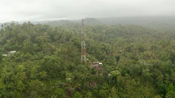 Thumbnail for Aerial View of Red and White Radio Tower in Dense Tropical Rainforest