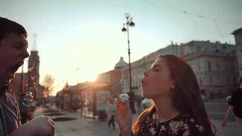 Love and Soap Bubbles Blow By Married Couple.