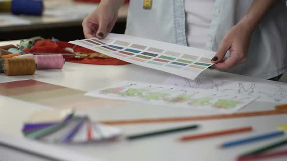 Thumbnail for Stylist Examining Palette Choosing Main Color of New Fashion Collection