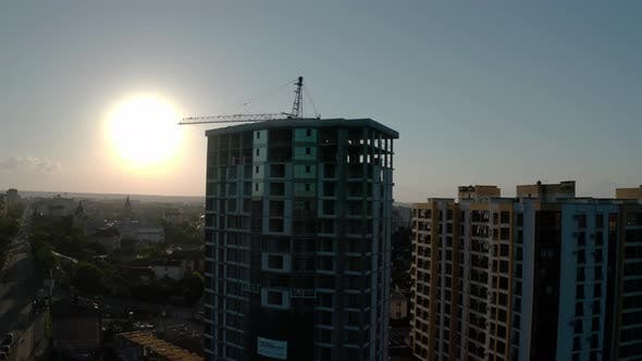 Thumbnail for Aerial Drone View of Construction in Sunset Light. Construction Site Building in City. Flying Around