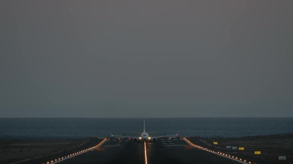 Thumbnail for A Runway with a Taking Off Plane