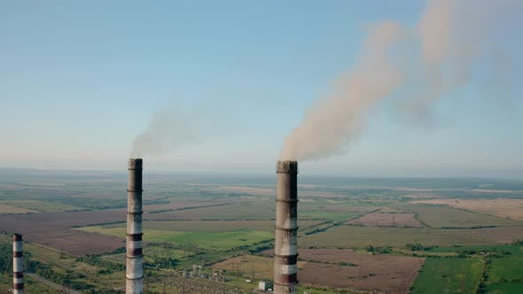 Thumbnail for Aerial Drone View of High Chimney Two Pipes with Grey Smoke From Coal Power Plant. Close Up V3