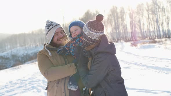 Thumbnail for Family with Child Hiking in Winter