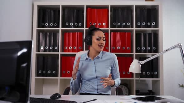Thumbnail for Businesswoman in Headphones Dancing and Singing a Song in Business Center