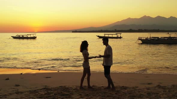 Thumbnail for Beautiful lady and man married on vacation live the dream on beach on white sand 4K background