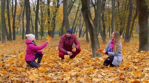 Positive Family with Girl Enjoying Fall Season