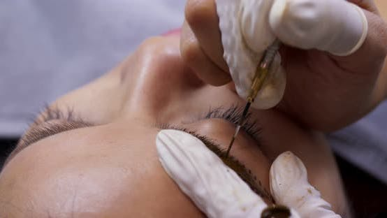Thumbnail for tattooing of eyebrows in beauty salon