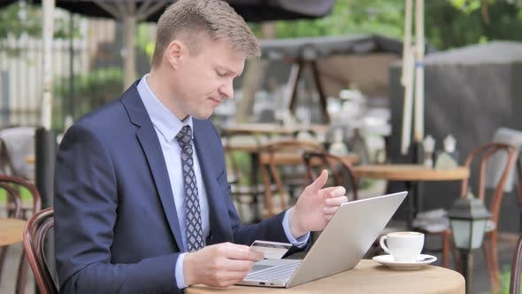 Thumbnail for Online Shopping Failure for Businessman Sitting in Cafe Terrace