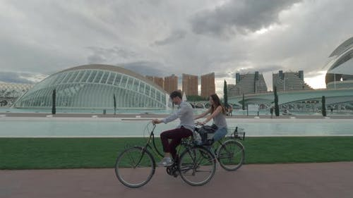A couple riding bicycles along the modern Valencia view
