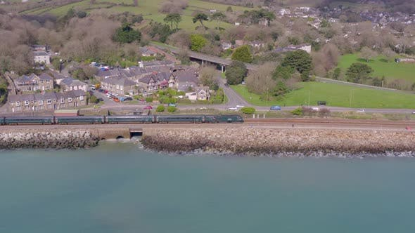 Commuter Train Alongside the Sea Aerial View