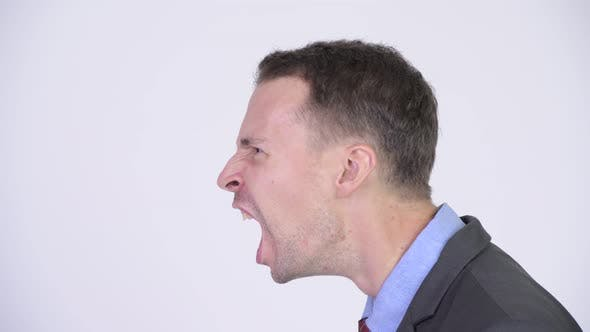 Thumbnail for Head Shot Profile View of Angry Businessman Shouting
