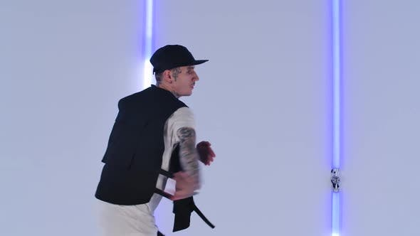 Thumbnail for Professional Hip Hop Dancer Practicing Street Dance Elements Against Bright Neon Lights in Studio