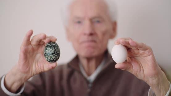 Thumbnail for Senior Man Holding Easter Eggs in Hands