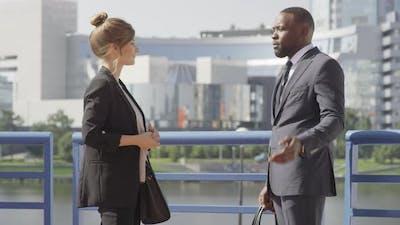 Business Partner Having Deal Outdoors
