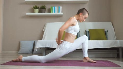 Beautiful Girl Is Doing Sports at Home Practising Yoga Asanas for Health and Beauty Exercising on