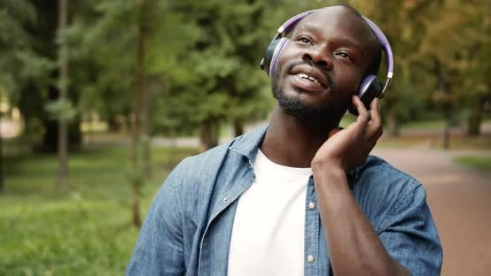 Cover Image for Afro-american Male in Headphones Singing