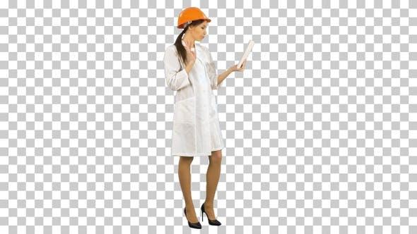 Female engineer in helmet having video, Alpha Channel