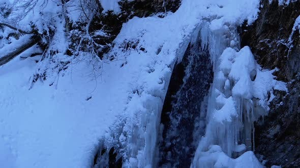 Thumbnail for Frozen Winter Waterfall Guk in the Carpathian Mountains in the Forest