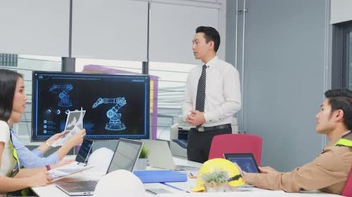 Young businesspeople group have discussion meeting about robot technology in office workplace.