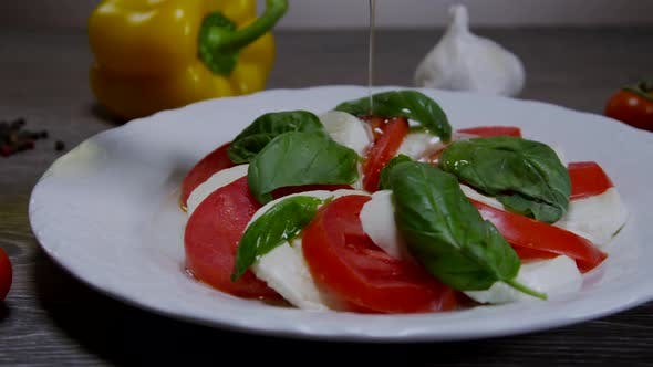 Thumbnail for Caprese Salad With Pouring Olive Oil 04