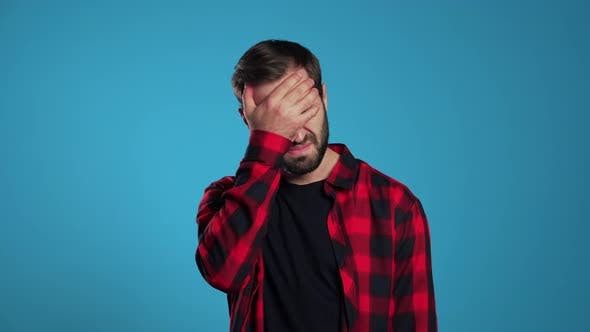 Thumbnail for Young Guy Covers His Face with Hand From Fatal Disappointment, Failure.