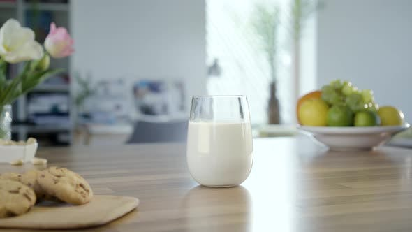 Thumbnail for Hand Takes Glass Of Milk And Place It Back