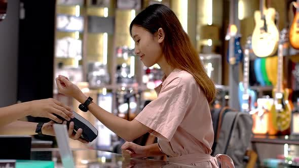 Thumbnail for Young Asian Woman Using Smartwatch Payment 03