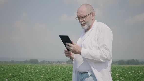 Thumbnail for Senior agronomist with a digital tablet