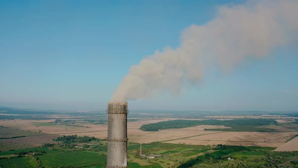 Thumbnail for Aerial Drone View of High Chimney Pipes with Grey Smoke From Coal Power Plant