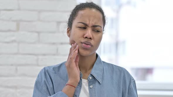 Cover Image for Young African Woman with Toothache, Tooth Pain