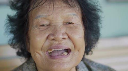 close-up of senior woman talking