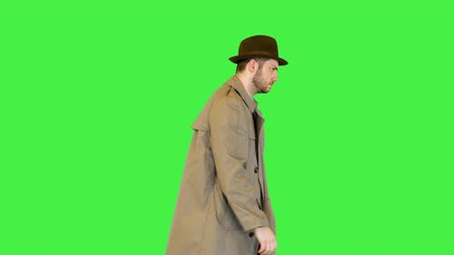 Serious Man Investigator Classic Private Detective Officer or Retro Police Inspector in Coat Walking