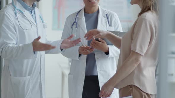 Thumbnail for Female Patient Shaking Hands and Talking with Two Doctors