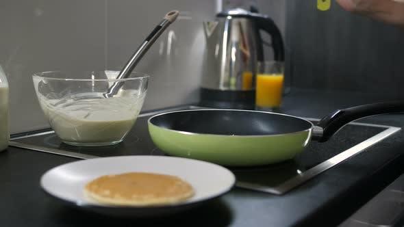 Thumbnail for Female Hand Flipping Pancake on Frying Pan