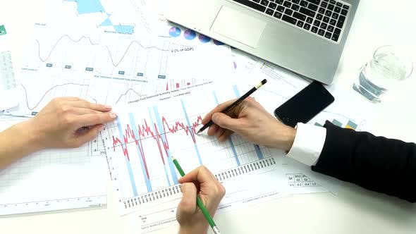 Thumbnail for Business Peoples Developing a Business Project and Analyzing Market Data Information