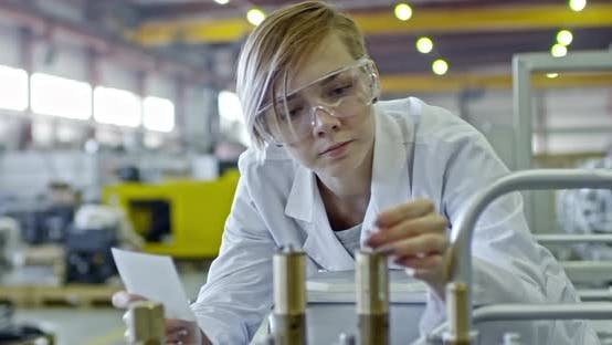 Thumbnail for Female Engineer Checking Industrial Equipment