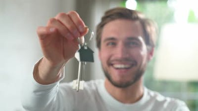 Housewarming Happy Man in a New Apartment the Male Smiles and Shows the Keys to the New Apartment to
