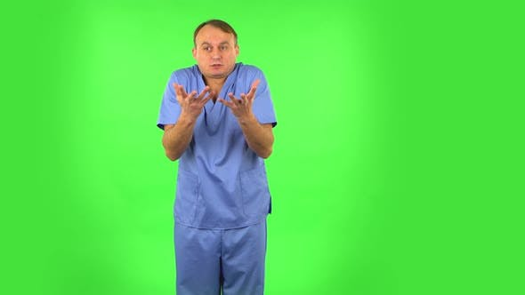 Thumbnail for Displeased Man Indignantly Talking To Someone, Looking at the Camera. Green Screen